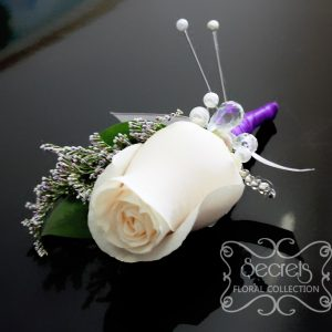 Fresh cream rose and purple limonium boutonniere, with purple and silver ribbon wrap and jewel embellishments - Toronto Wedding Flowers Created by Secrets Floral Collection