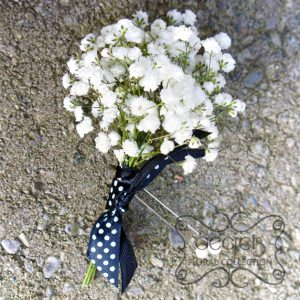 Fresh baby's breath boutonniere, embellished with black and white polka-dot ribbon - Toronto Wedding Flowers Created by Secrets Floral Collection