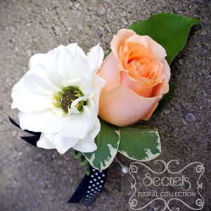 Fresh peach rose and white dahlia boutonniere, embellished with black and white polka-dot ribbon (top-view) - Toronto Wedding Flowers Created by Secrets Floral Collection