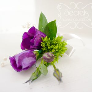 Fresh purple lisianthus and green trachelium boutonnière, embellished with pearl strands and silver ribbon (top-view) - Toronto Wedding Flowers Created by Secrets Floral Collection
