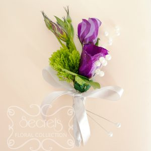 Fresh purple lisianthus and green trachelium boutonnière, embellished with pearl strands and silver ribbon (front-view) - Toronto Wedding Flowers Created by Secrets Floral Collection