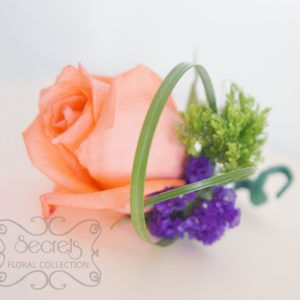 Fresh peach rose, green trachelium, and purple statice flowers pin-on corsage, embellished with pearls and green wrap (top-view) - Toronto Wedding Flowers Created by Secrets Floral Collection
