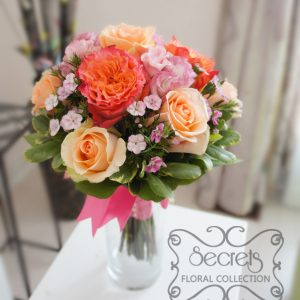 Fresh two-tone peach garden roses (free spirit), peach standard roses, bi-colour pink lisianthus, and light pink sweet william bridesmaid bouquet, with salmon pink wrap (top-view) - Toronto Wedding Flowers Created by Secrets Floral Collection