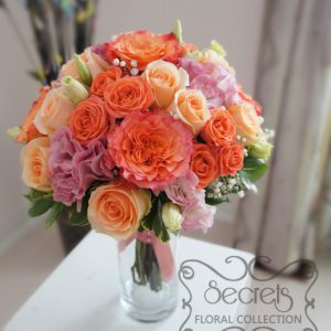 Fresh two-tone peach garden roses (free-spirit), peach standard and spray roses, solid pink and bi-colour pink lisianthus, and baby's breath bridal bouquet, with coral pink ribbon wrap (top-view) - Toronto Wedding Flowers by Secrets Floral Collection