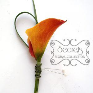 Fresh two-tone blood orange calla lily and lily grass boutonniere, embellished simply with green twine - Toronto Wedding Flowers Created by Secrets Floral Collection