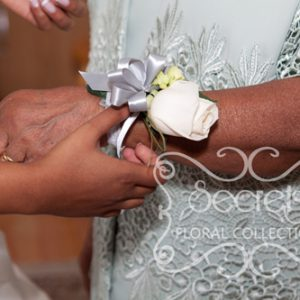 Bride Helping the Mother to Wear Her Wristlet