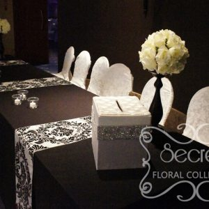 Receiving Table is Decorated with Ivory Rose Ball Arrangements, Bling! Bling! Money Box, and Small Bling! Bling! Candles