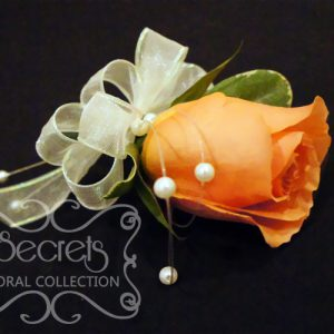 Fresh Coral Rose and Pittosporum Pin-On Corsage with Pearl Strands Accent for the Mothers (Side View)