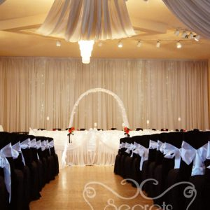 Black Polyester Chair Covers with White Satin Sashes