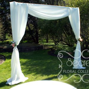 Our modern wedding arch, draped with soft white voile