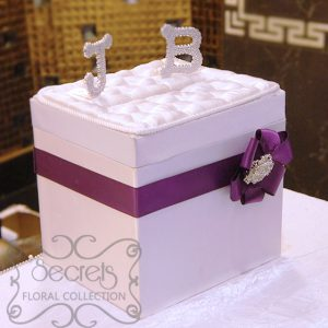 Our white satin money box, embellished with purple accent, and crystallized initials of the couple