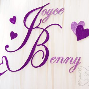 Close-up of purple glittery names. Designed with trailing heart