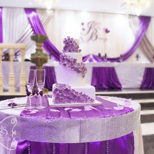 Close-up of the cake table. Beautiful hydrangea cake, surrounded with our purple champagne flutes and cake serving set