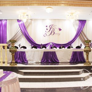 An extra long backdrop, with royal purple and silver satin accents