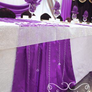 Close-up of head table. The crystal strands add a lot of glitz to the table
