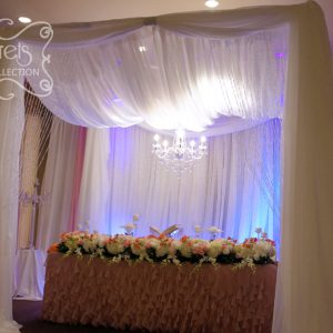 A Crystallized Cream Voile Canopy with Hanging Chandelier (Close-Up)