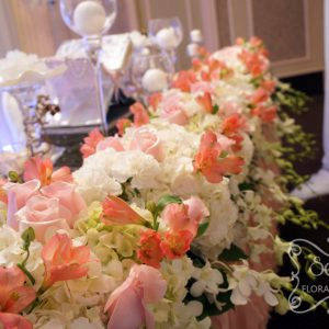 Long Head Table Floral Arrangement with Cream Hydrangea, Carnations, Dendrobium Orchids, Pink Roses, and Coral Alstromeria (Close-Up)