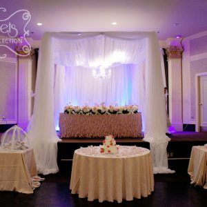 A Crystallized Cream Voile Canopy with Hanging Chandelier (Front View)