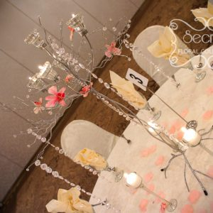 Centrepiece with Chrome Wedding Tree, Embellished with Pink Dendrobium Orchids and Crystal Stands, Surrounded with Stemmed Glass Candle Holders