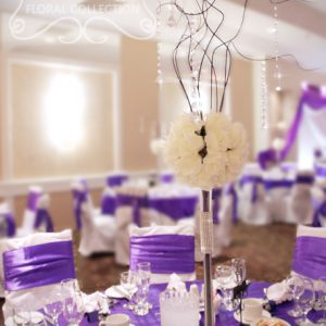 Centrepiece is made with ivory rose ball and purple branches, with crystals hanging on the branches - Toronto Wedding Decor Created by Secrets Floral Collection