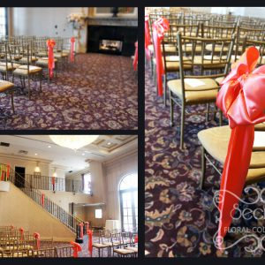 Ceremony aisle and staircases are decorated with coral pink satin bows - Toronto Wedding Decor Created by Secrets Floral Collection