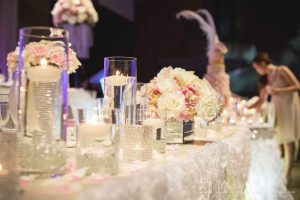 Wedding head and cake tables are filled with lots of crystals and candles, for an added touch of romance and ambience. Photo by Andes Lo Photography - Toronto Wedding Decor Created by Secrets Floral Collection