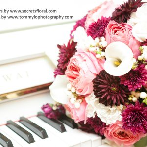 Fresh coral pink garden roses (romantic antique), burgunday dahlias, white calla lilies, snowberries, white lisianthus, and fuchsia flat mums bridal bouquet - Toronto Wedding Flowers by Secrets Floral Collection