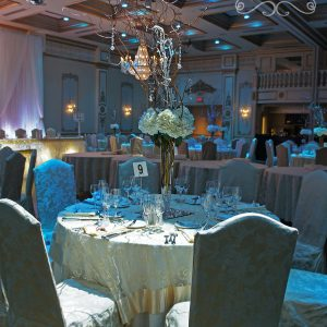 Winter wonderland centrepiece with snowy branches, and embellished with crystals stands - Toronto Wedding Decor Created by Secrets Floral Collection