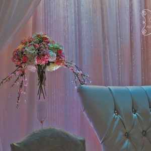 Large enlongated arrangement near head table, filled with roses, cherry blossoms, peonies, phalaenopsis orchids, and hydrangea - Toronto Wedding Decor Created by Secrets Floral Collection