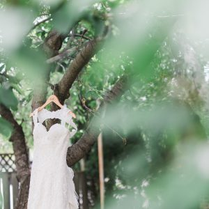 Gorgeous lace wedding dress for a French garden and greenery wedding. Toronto wedding flowers and decor by Secrets Floral.