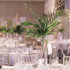 Fresh tall greenery centrepiece arrangement, with gold manzanita branch. Suspending glass globes with candles. Toronto wedding flowers and decor at Fontana Primavera by Secrets Floral.