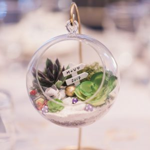 Succulent glass terrarium centreipece arrangement on gold stand, created by couple. Toronto wedding flowers and decor at Fontana Primavera by Secrets Floral.