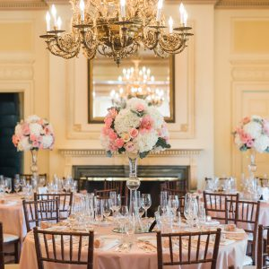 Fresh tall floral centrepiece arrangements, with cream and blush pink roses, hydrangea, and dusty miller. Toronto wedding flowers at Graydon Hall by Secrets Floral.